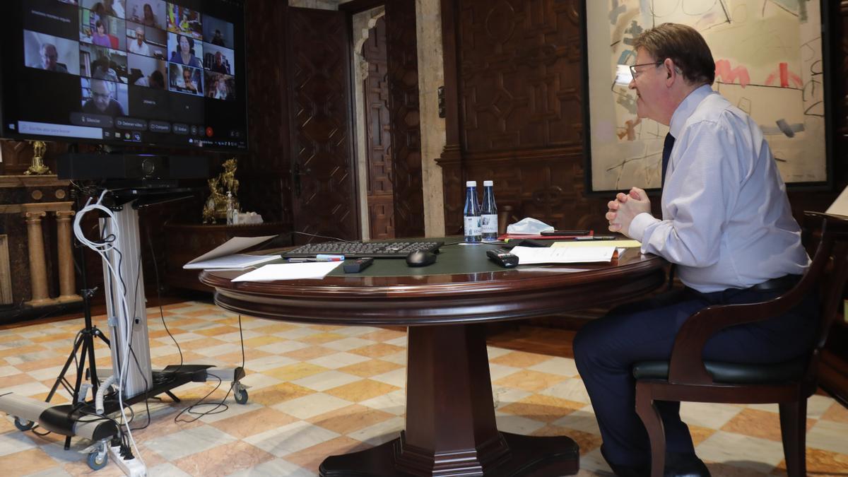 El president de la Generalitat Valenciana, Ximo Puig, en la reunión con expertos para analizar la evolución de la pandemia.