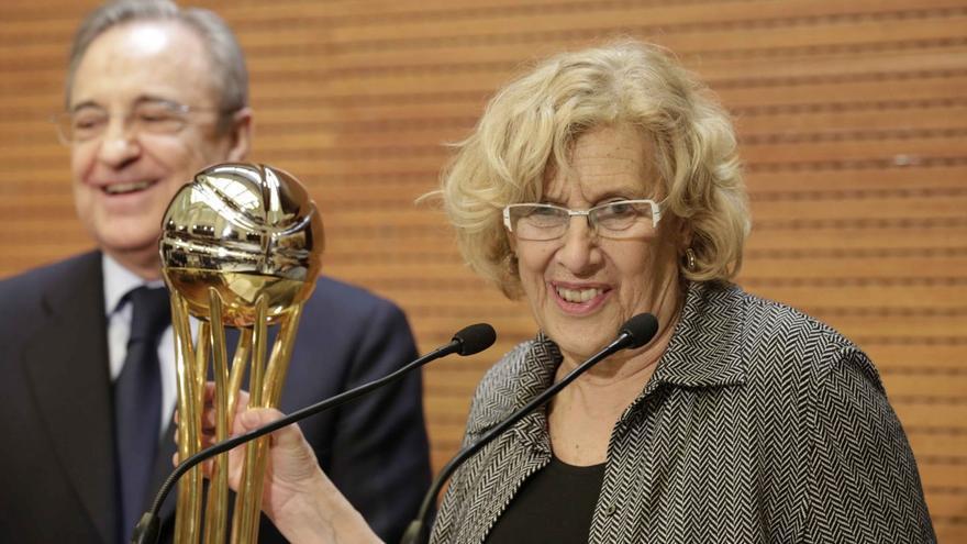 Manuela Carmena junto con Florentino Pérez en un acto