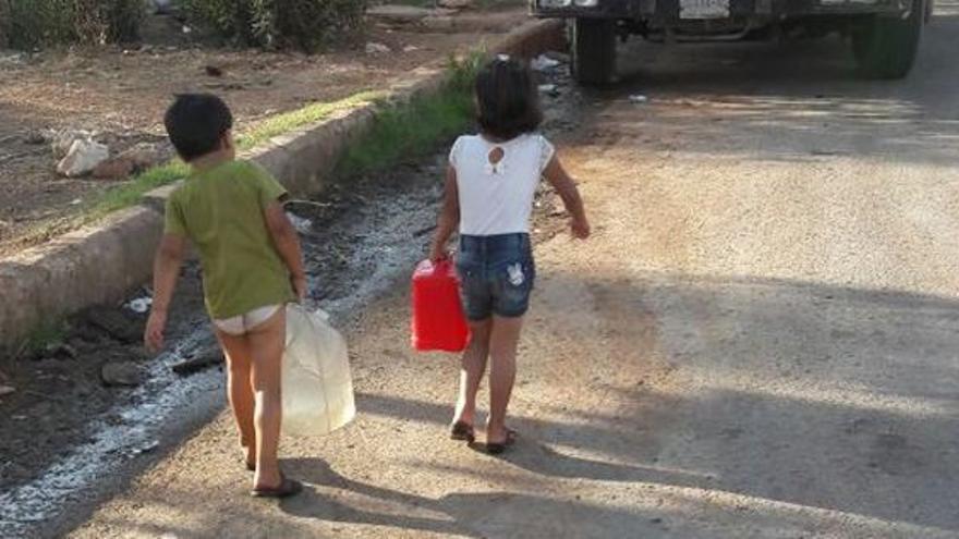 Niños en la ciudad en guerra de Alepo, en Siria
