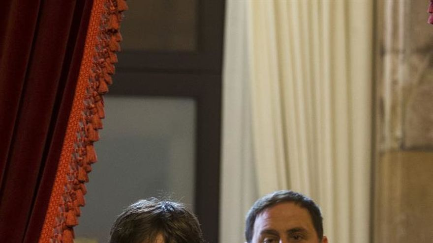Puigdemont y Junqueras entrando en el Parlament