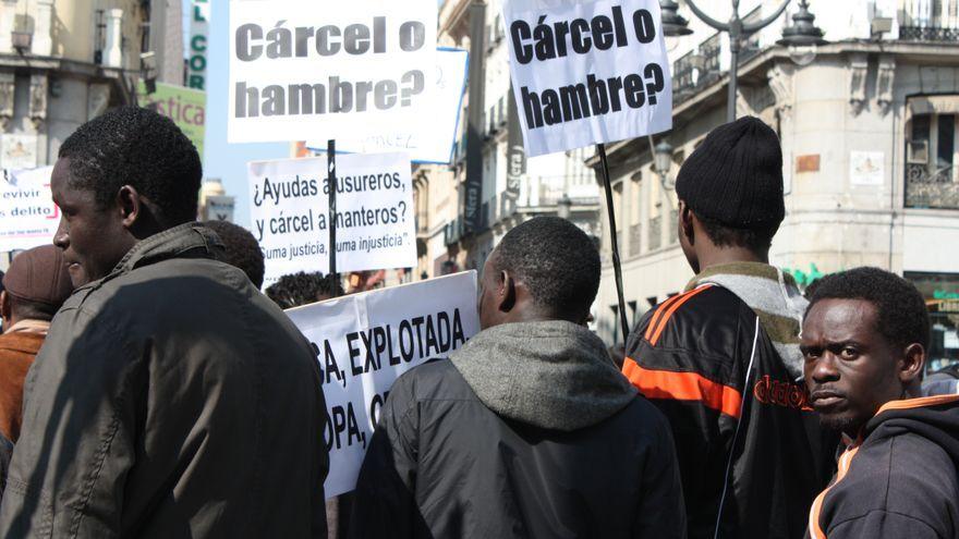 Personas migradas en una manifestación por sus derechos.