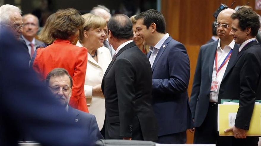 Merkel, Hollande, Rajoy y Tsipras en la reunión del Eurogrupo del 12 de julio. / Efe
