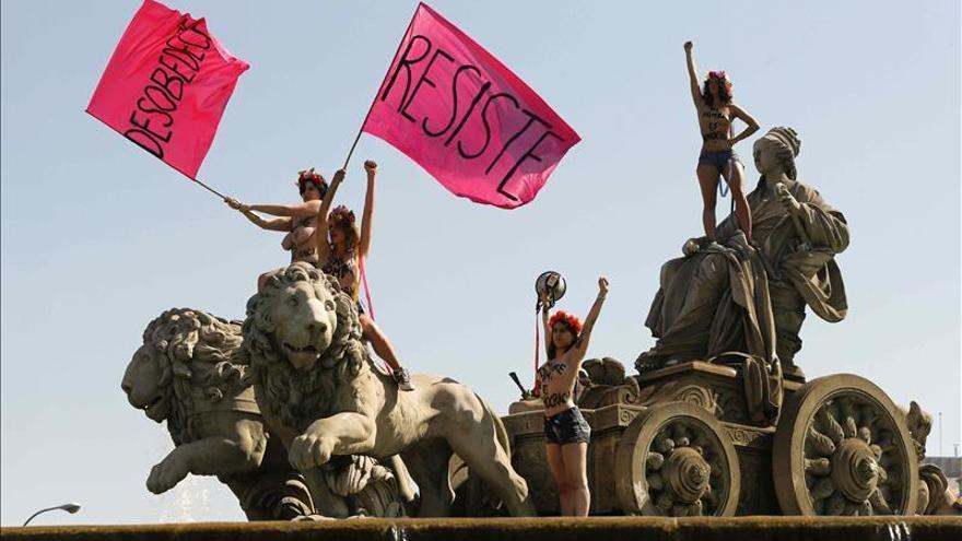 La protesta de Femen el día que entra en vigor la Ley Mordaza / EFE