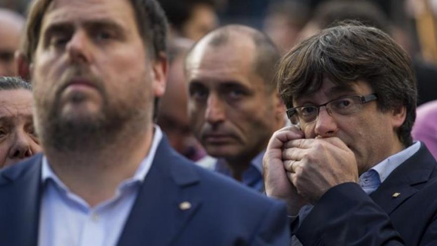 Junqueras y Puigdemont. Archivo EFE. Enric Fontcuberta