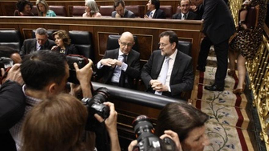 El Ministro De Hacienda, Cristóbal Montoro, Y El Presidente Del Gobierno, Marian