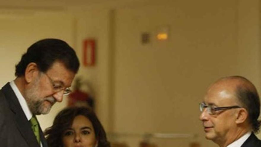 Presidente del PP, Mariano Rajoy, con la portavoz del PP en el Congreso, Soraya