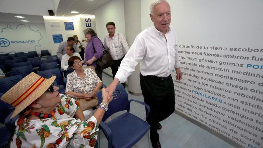 Margallo reconoce una situación delicada en el PP y triste por la baja participación