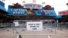 A sign directs people to observe social distancing guidelines at the Wharf in Washington, DC, USA, 29 May 2020.