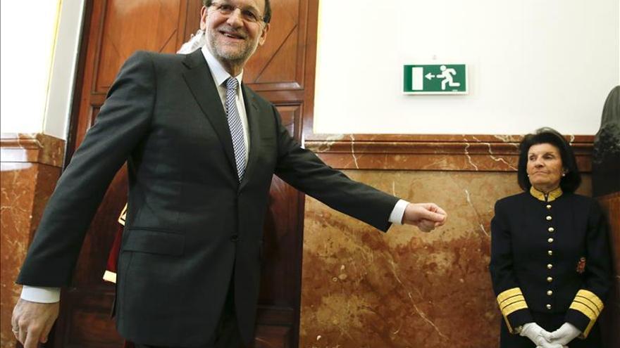 Rajoy augura que en 2014 los españoles ya percibirán la mejoría económica