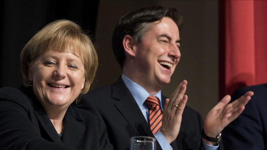 """Abren los colegios electorales en el """"Land"""" alemán, barómetro para las generales de 2013"""