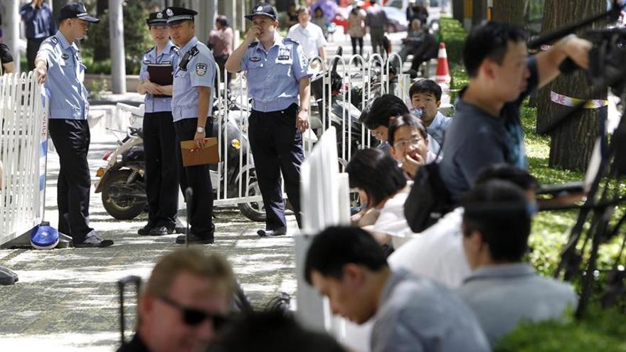 China no juzgará a cinco policías por la muerte de un activista bajo custodia
