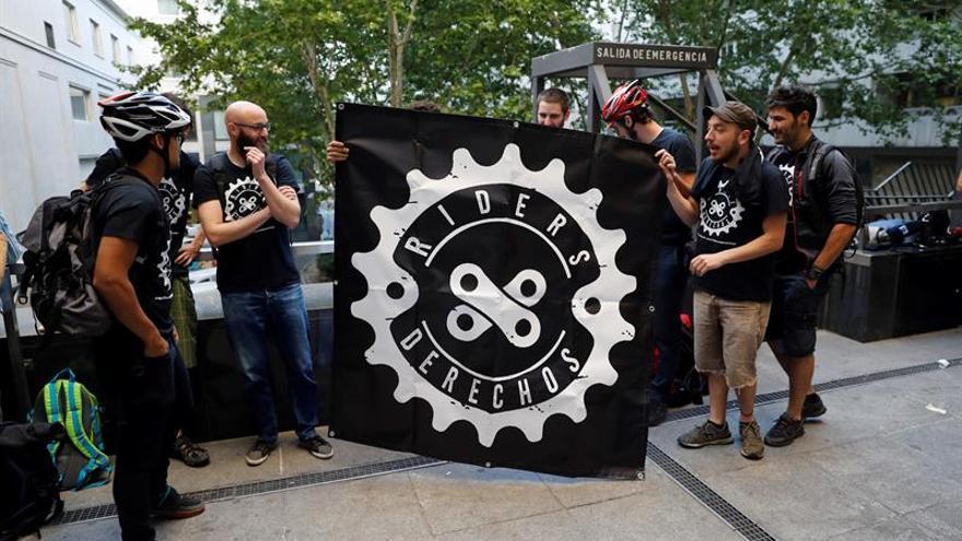 Algunos repartidores en el macrojuicio que se celebró en Madrid contra Deliveroo.