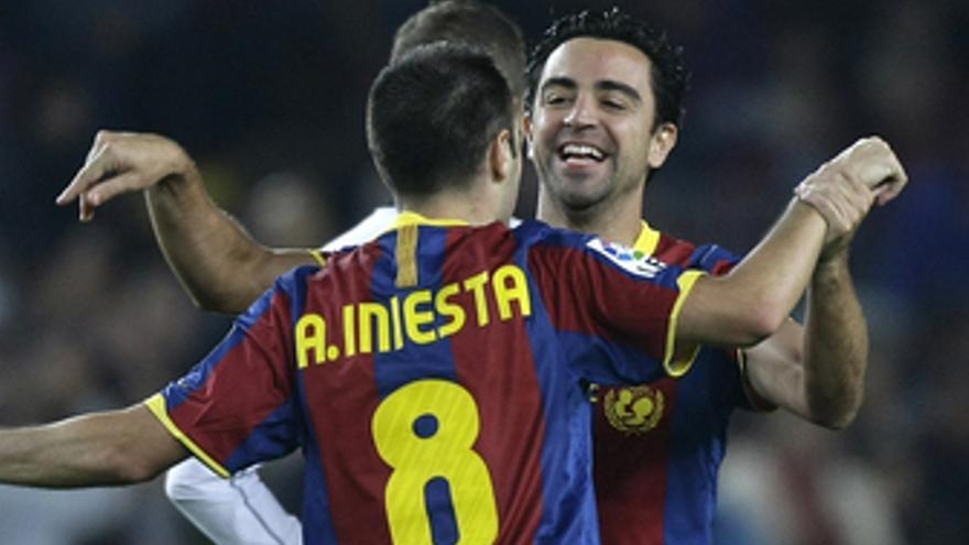 Xavi Hernández e Iniesta