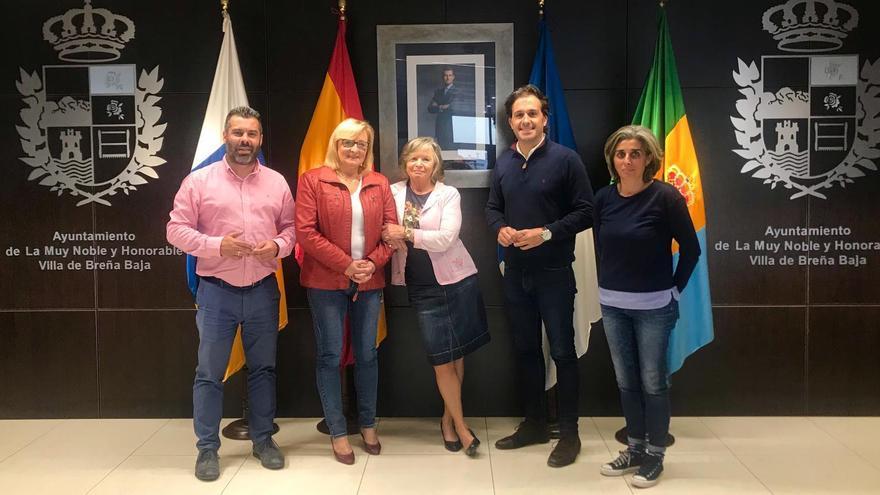 Autoridades municipales y miembros de la comunidad alemana.