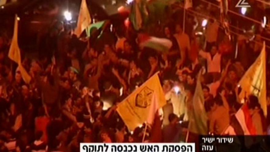 Imágenes de las celebraciones en Gaza por el alto el fuego en un canal israelí.