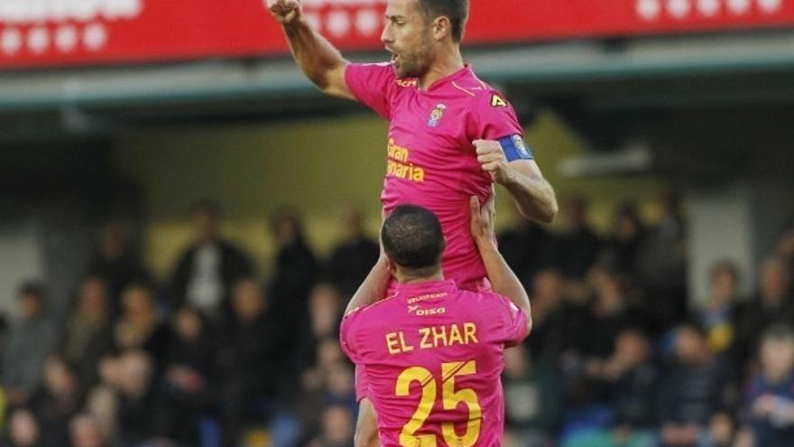El jugador de la UD Las Palmas, David García, celebra el gol conseguido en El Madrigal ante el Villarreal.