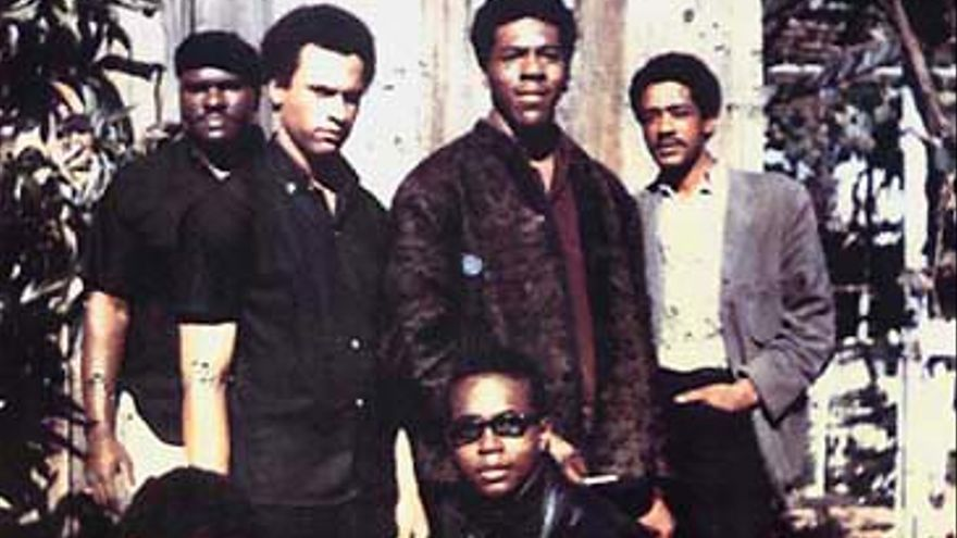 """Original six members of the Black Panther Party (1966) Top left to right: Elbert """"Big Man"""" Howard, Huey P. Newton (Defense Minister), Sherwin Forte, Bobby Seale (Chairman) Bottom: Reggie Forte and Little Bobby Hutton (Treasurer)."""