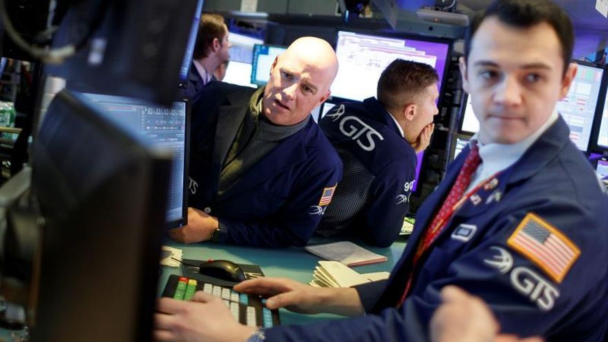 Traders work on the floor of the New York Stock Exchange at the start of the trading day in New York, New York, USA, 03 December 2019.
