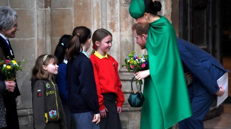 Meghan Markle y el príncipe Harry en su último acto oficial como miembros de la realeza.
