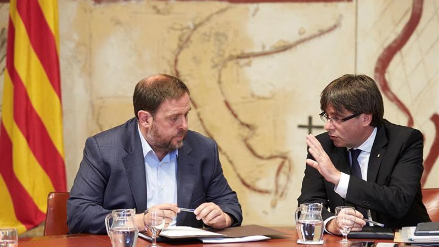 Puigdemont y Junqueras recibirán mañana a Homs antes de que declare por el 9N
