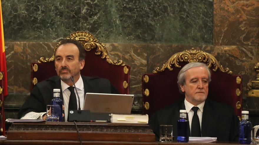 Los jueces Manuel Marchena y Juan Ramón Berdugo en la vista de las cuestiones previas del juicio en diciembre de 2018.