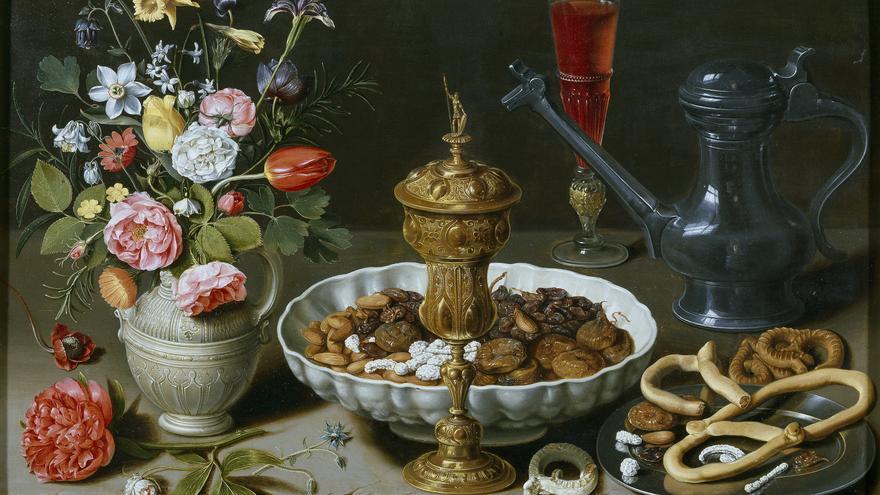 Bodegón con flores, copa de plata dorada, almendras, frutos secos, dulces, panecillos, vino y jarra de peltre/ Clara Peeters (1611)