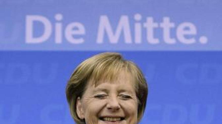 Angela Merkel, visiblemente emocionada este domingo en Berlín. (EP)