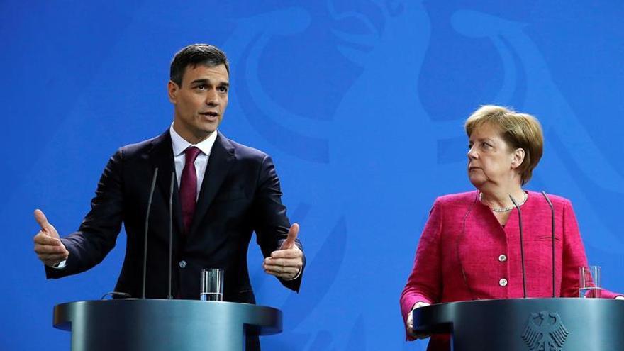 Pedro Sánchez y Angela Merkel en una rueda de prensa.