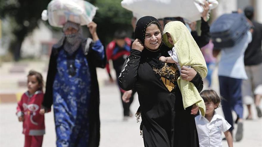 Veinte familias originarias de Mosul llegan al noreste de Siria