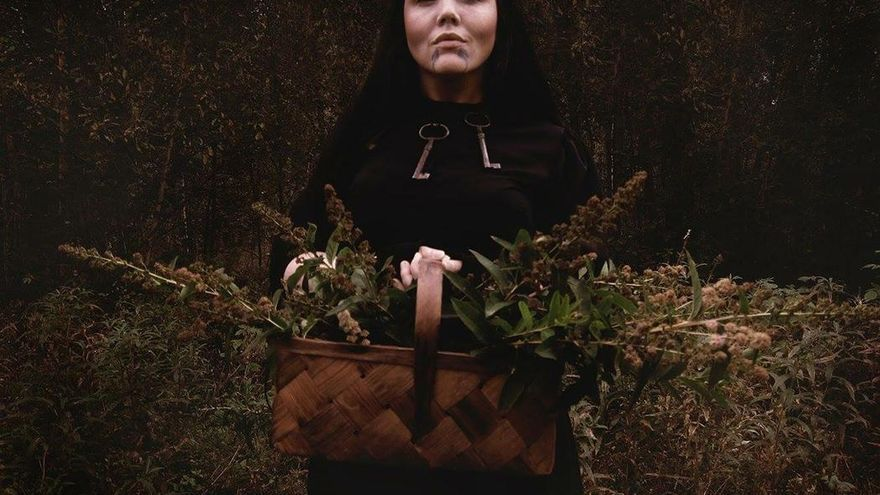 Witch in the dark scandinavian wilderness, witch in the woods.