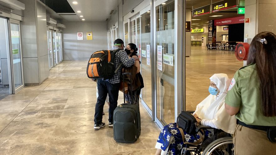 A family says goodbye when informed that they cannot enter together