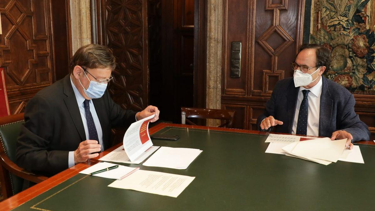 Un momento de la reunión mantenida entre el president Ximo Puig y el conseller de Hacienda, Vicent Soler.