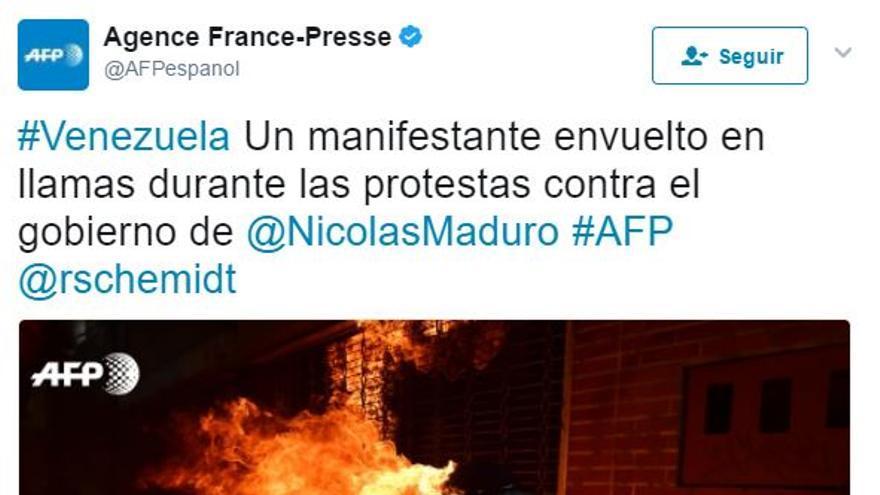 FRANCE PRESSE MANIFESTANTE EN LLAMAS VENEZUELA
