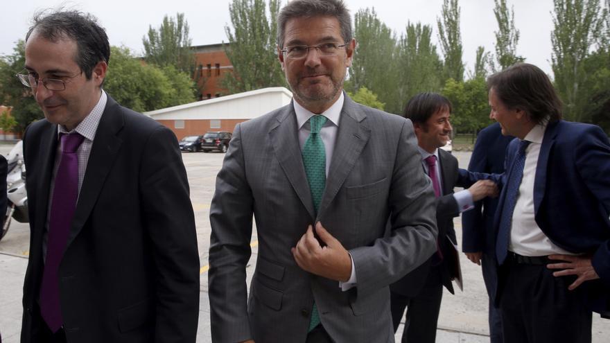 El rector Suárez (izquierda), junto al ministro de Justicia antes de unas conferencias