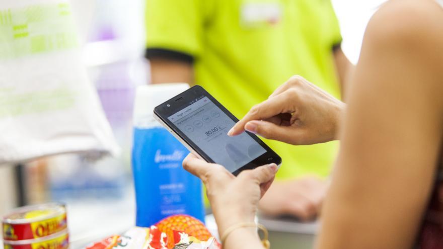 ING permitirá retirar dinero en efectivo en DIA con una aplicación móvil.