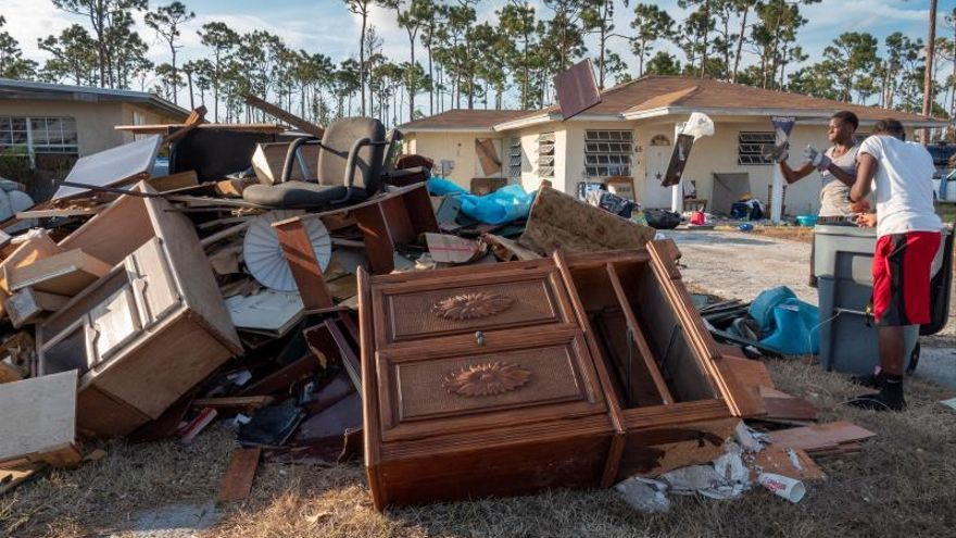 Residents of Heritage Community are throwing their damaged properties after the floods, during the past hurricane Dorian, in Freeport, Bahamas, 08 September 2019.