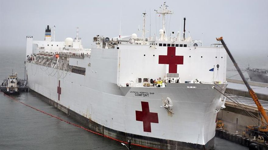 A handout photo made available by the Federal Emergency Management Agengcy shows the USNS Comfort arriving at New York Harbor in New York, New York, USA, 30 March 2020 (issued 31 March 2020).