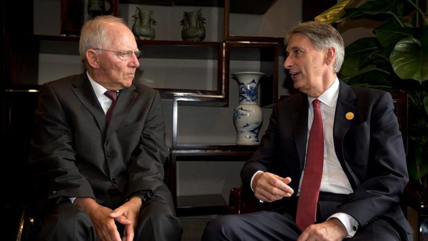 Schäuble reivindica un acuerdo global para gravar las transacciones financieras