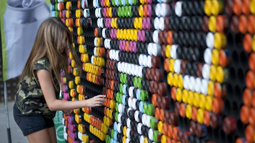 Hasta latas recicladas en farcama se convierten en for Mural nuestra carne