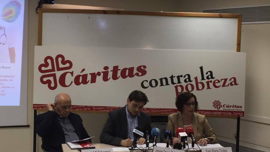 El director de Cáritas Valencia, Ignacio Grande, la secretaria general, Fani Raga y el Delegado Episcopal, José María Taberner,