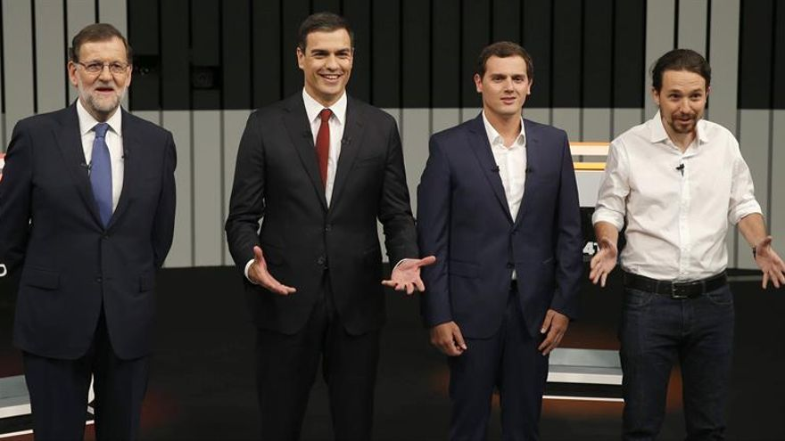 Los cuatro candidatos, en el debate del 13J