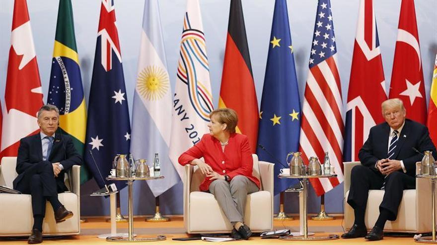 Donald Trump, Angela Merkel y Mauricio Macri, en la cumbre del G20.