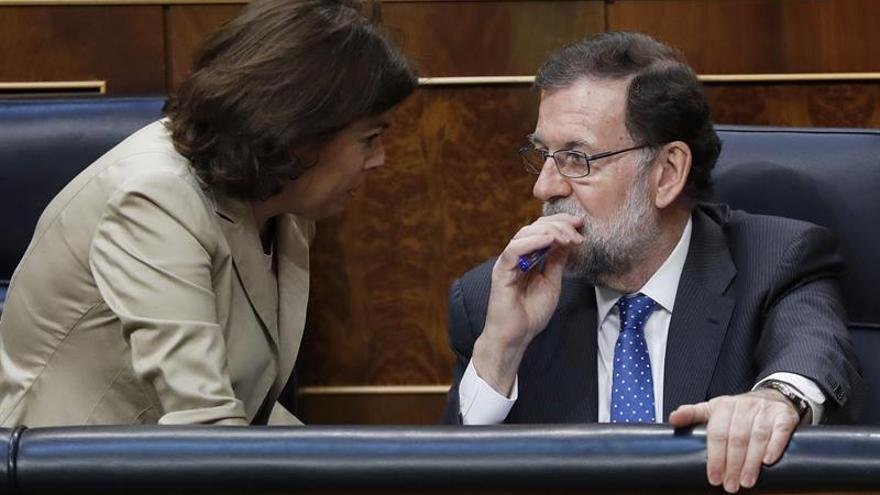 Mariano Rajoy y Sorya Sáenz de Santamaría, en el Congreso de los Diputados.