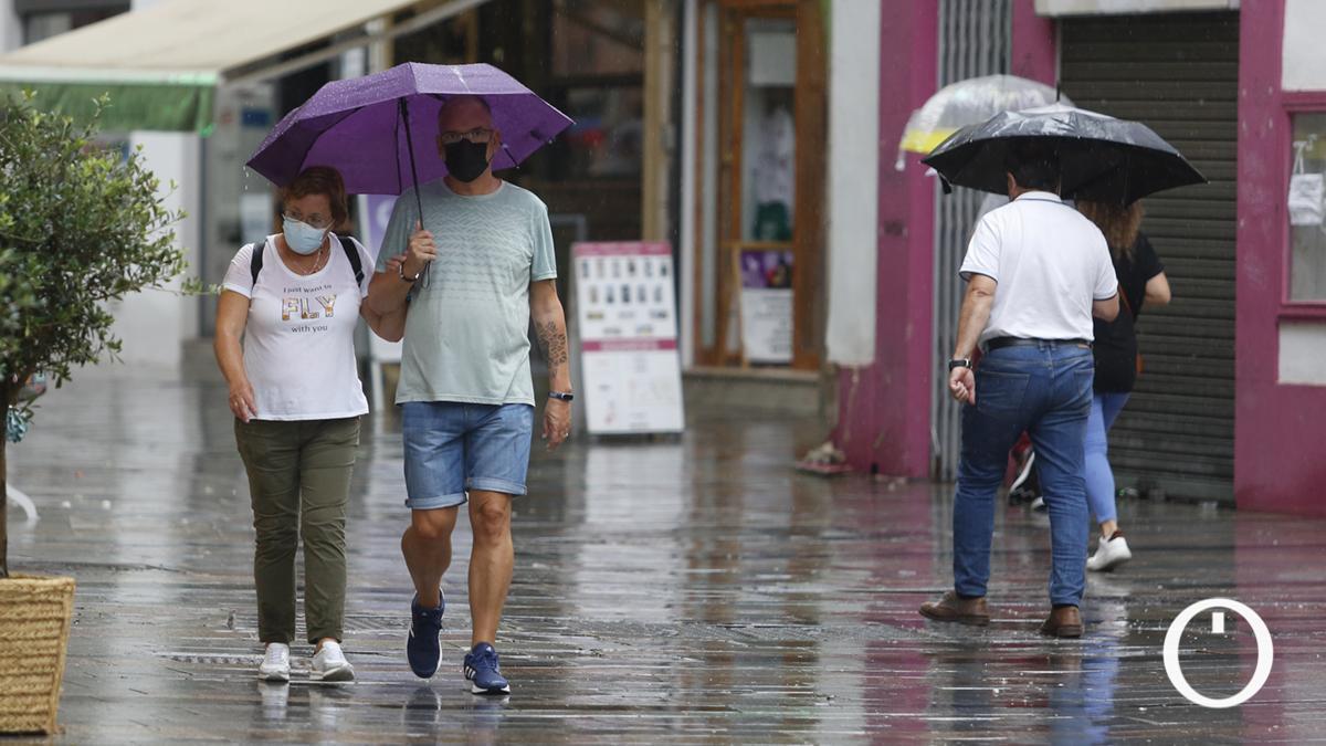 Cordobeses bajo las lluvias de septiembre