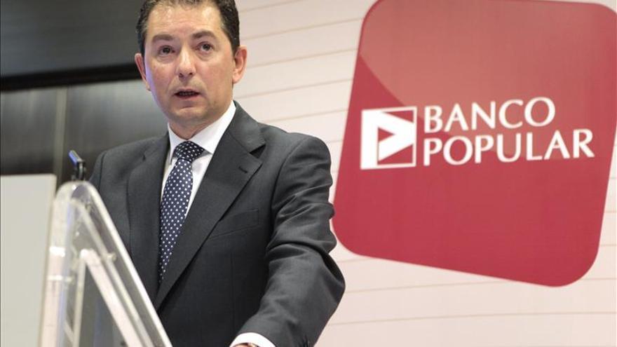 El Banco Popular propondrá a la junta agrupar una acción nueva por cada cinco antiguas