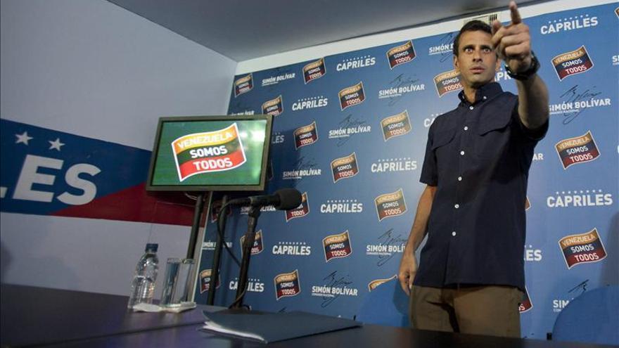 El Poder Electoral de Venezuela aprueba revisar todos los votos y Capriles acepta