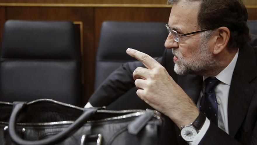 El presidente del Gobierno, Mariano Rajoy, en su escaño del Congreso. / EFE