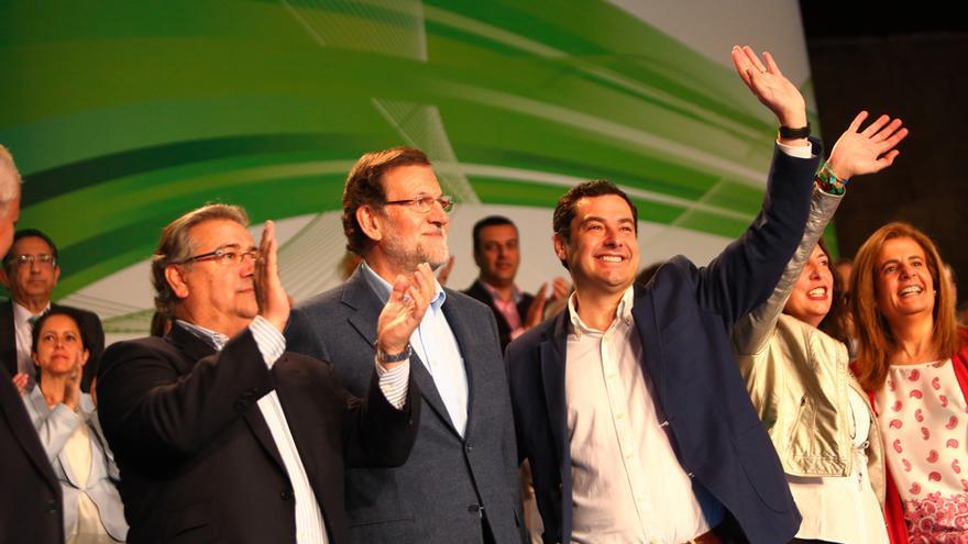 Juan Ignacio Zoido, Mariano Rajoy y Juan Manuel Moreno