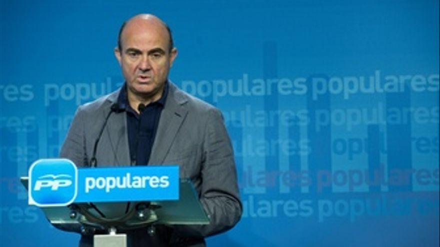 Luis de Guindos en la sede del PP