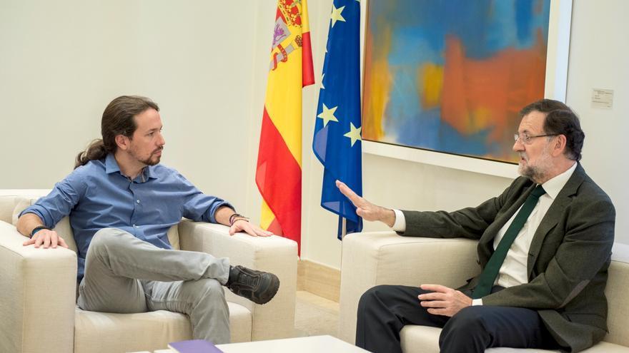 El secretario general de Podemos, Pablo Iglesias, y el presidente del Gobierno, Mariano Rajoy, en Moncloa. / Podemos